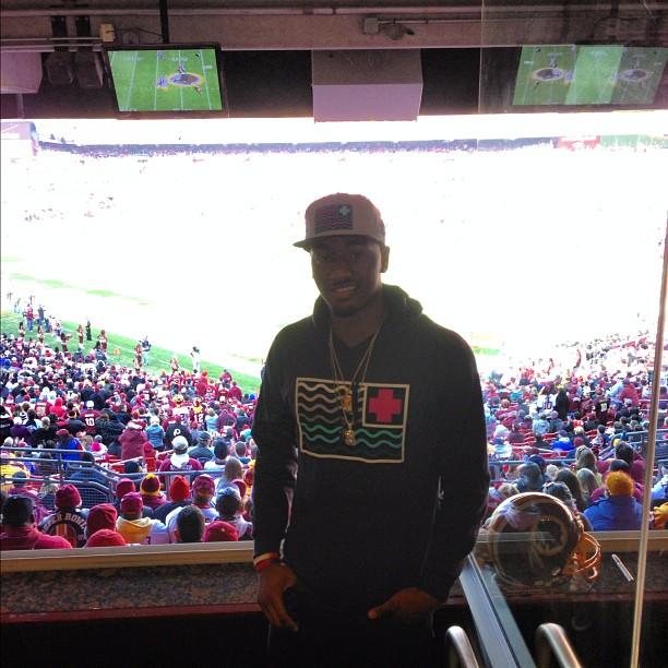 John Wall attended an Washington Redskins game a couple weeks ago wearing a $45 Pink Dolphin Olympics flag hat and $80 Olympic Flag Hoodie