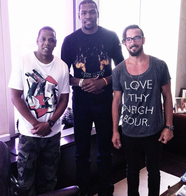 Kevin-Durant-signs-with-jay-z-roc-nation-sports-wearing-givenchy-Doberman-Print-tee