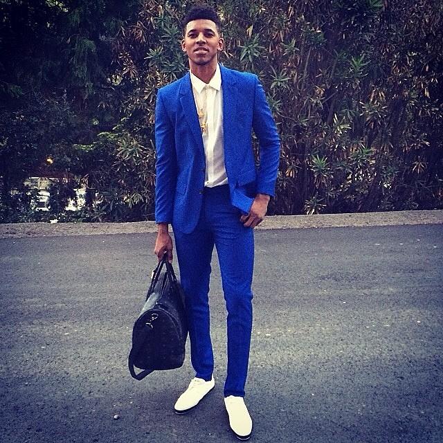 Nick-Young-Instagram-blue-suit-MCM-duffel-Bag-