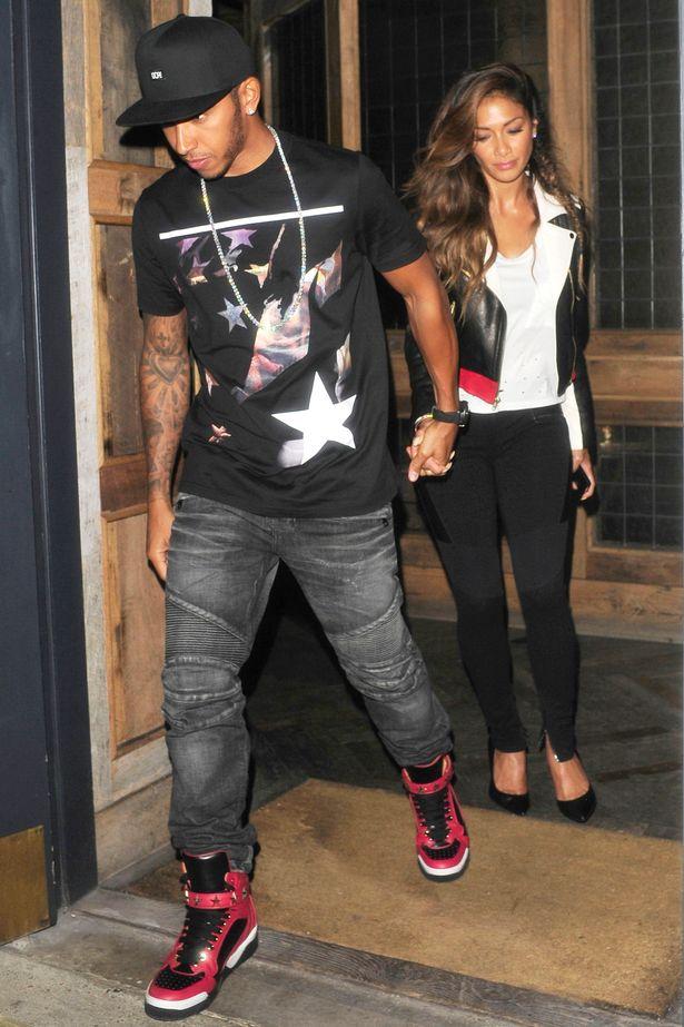 Nicole-Scherzinger-and-Lewis-Hamilton-Givenchy- t-shirt-Balmain denim biker jeans-Givenchy-Tyson-sneakers.