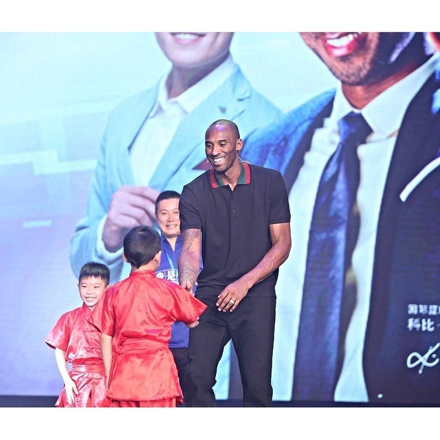 STYLE: Kobe Bryant's Lenovo Event Gucci black pique web striped collar polo.