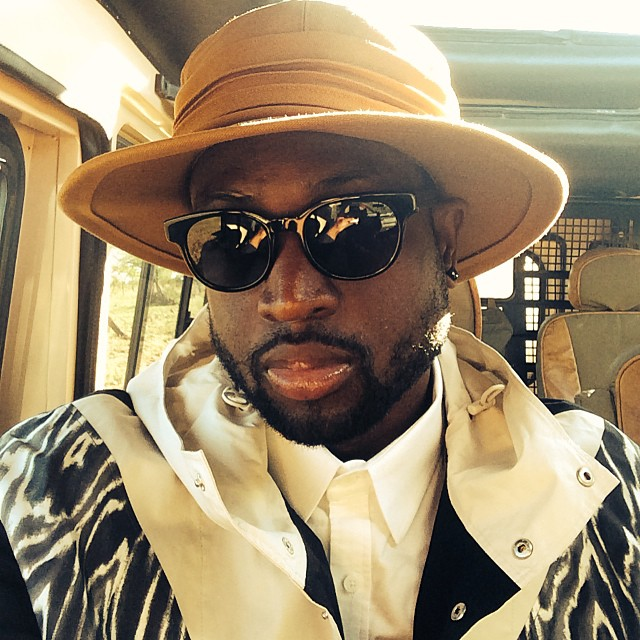 STYLE: Dwyane Wade's Honeymoon 3.1 Phillip Lim Grain Silk Twill Jacket And Z Malan Safari Hat