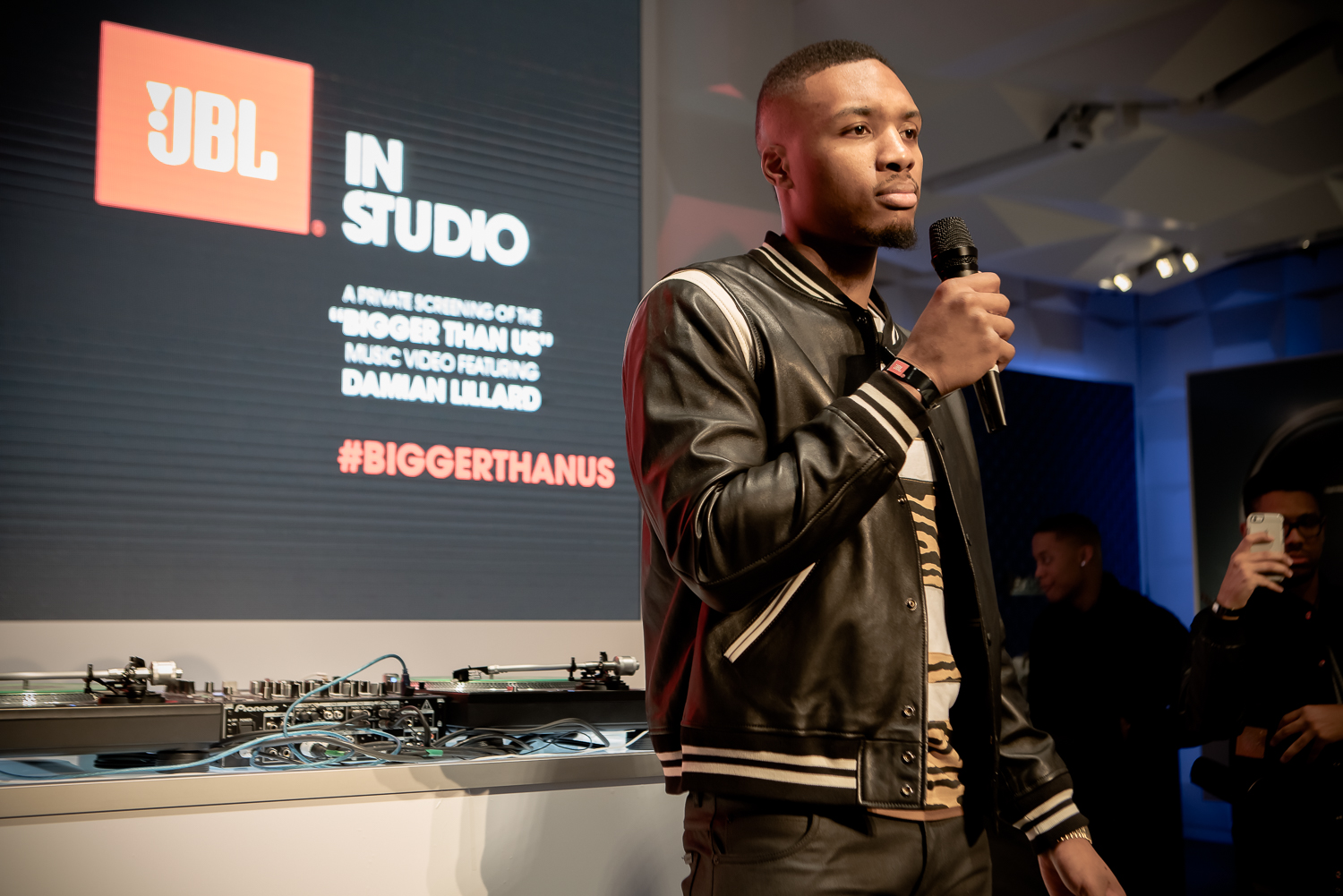 "STYLE: Damian Lillard Wears Coach Leather Baseball Jacket For His ""Bigger Than US"" Music Video Launch Event"