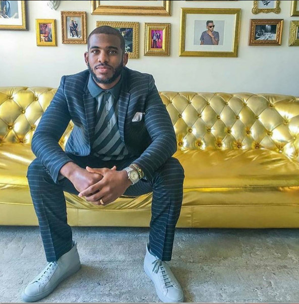 Chris Paul Visits Roc Nation Sports Wearing Dolce & Gabbana Suit & Common Project Sneakers: Fashion Tips For Men