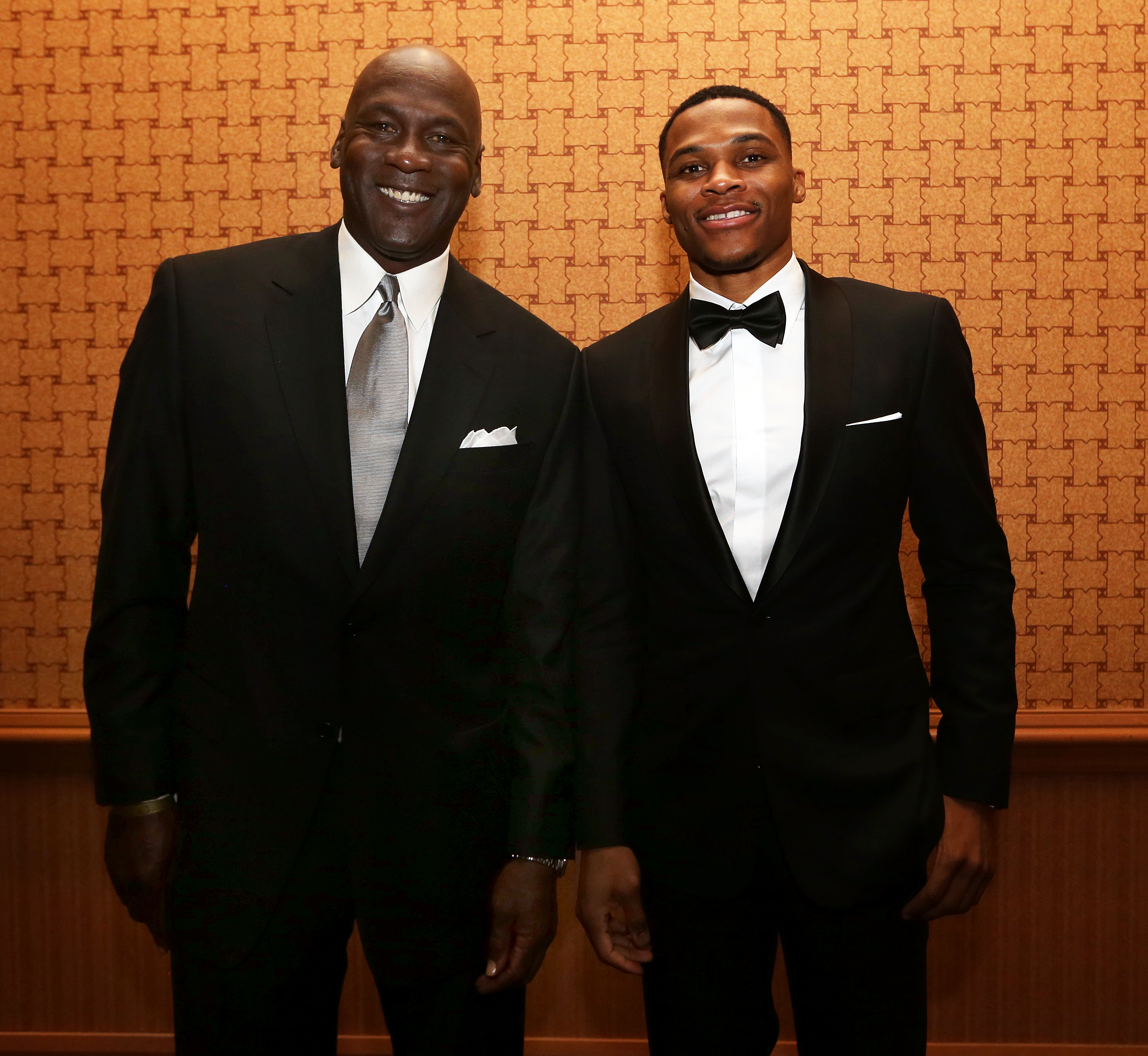 OKLAHOMA CITY, OK - NOVEMBER 17: Oklahoma City Thunder guard Russell Westbrook is inducted into the Oklahoma Hall of Fame by NBA legend Michael Jordan on November 17, 2016 at the Cox Convention Center in Oklahoma City, Oklahoma. NOTE TO USER: User expressly acknowledges and agrees that, by downloading and or using this Photograph, user is consenting to the terms and conditions of the Getty Images License Agreement. Mandatory Copyright Notice: Copyright 2016 NBAE (Photo by Layne Murdoch/NBAE via Getty Images)