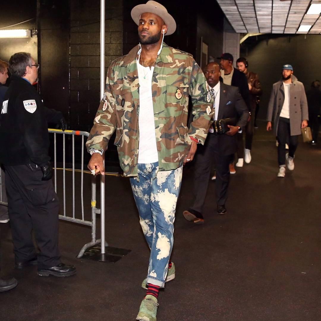 9297e3ac433e Lebron James' Toronto Game 6 Gucci Bleached Denim Punk Jeans and Camouflage  Parka Jacket