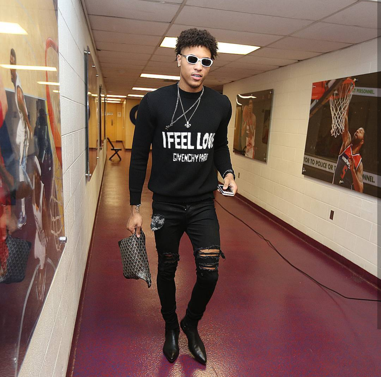 "Kelly Oubre Jr's Instagram Givenchy ""I Feel Love"" Sweater and Saint Laurent Chelsea Boots"