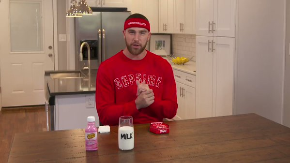 Travis Kelce Ate Paqui's Spiciest Chip In The World Wearing Supreme x Louis Vuitton Sweater